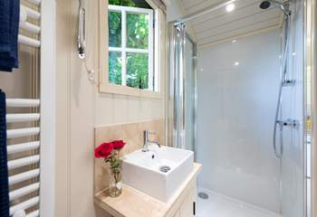 The en suite shower-room is beautifully fitted including a heated towel rail.