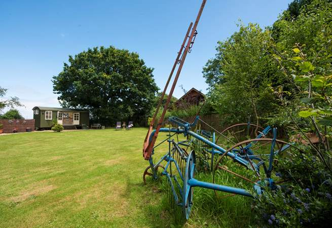 There is a reminder you are on a working farm with clever use of old farm machinery as garden ornaments.