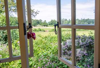 The view from your kitchen window across open fields which are grazed by cattle and sheep.