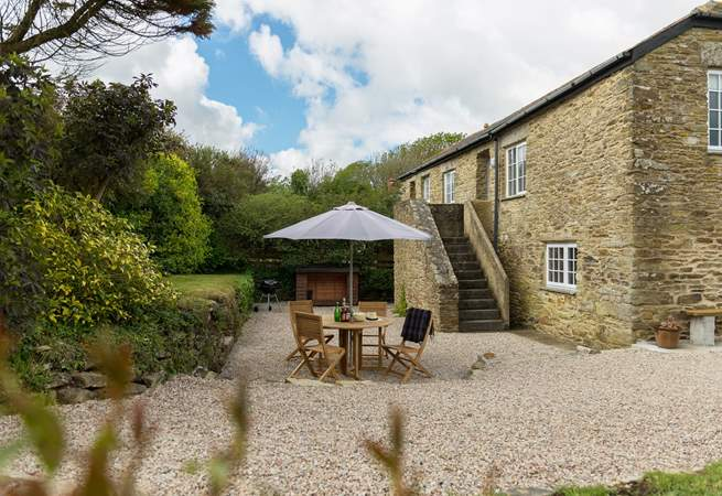 Carminowe View Cottage is a reverse level semi-detached stone cottage with its own enclosed private garden.
