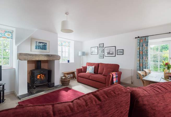 Two comfy sofas around the fireplace...the perfect place to curl up with a good book.