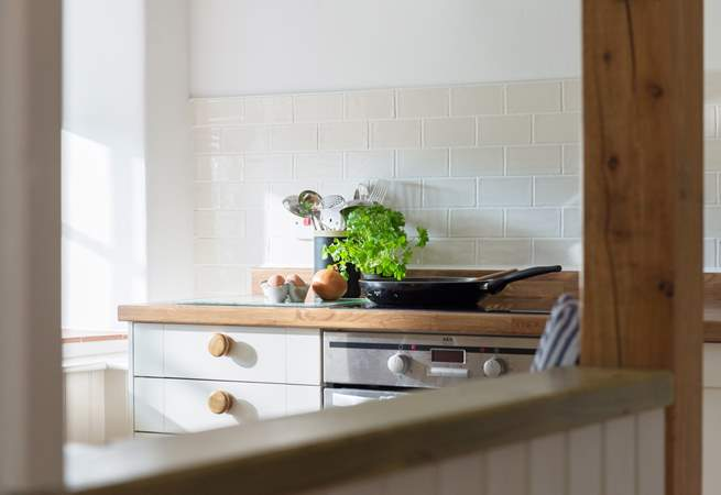 This stylish kitchen is well-equipped and has everything you need to make a meal or a cuppa.
