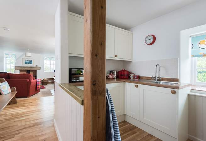The small but perfectly formed kitchen also has a utiilty-room opposite with the washing machine and a drying rack.