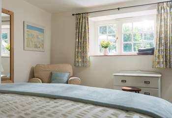 This double bedroom is also beautifully furnished and looks out onto the garden.