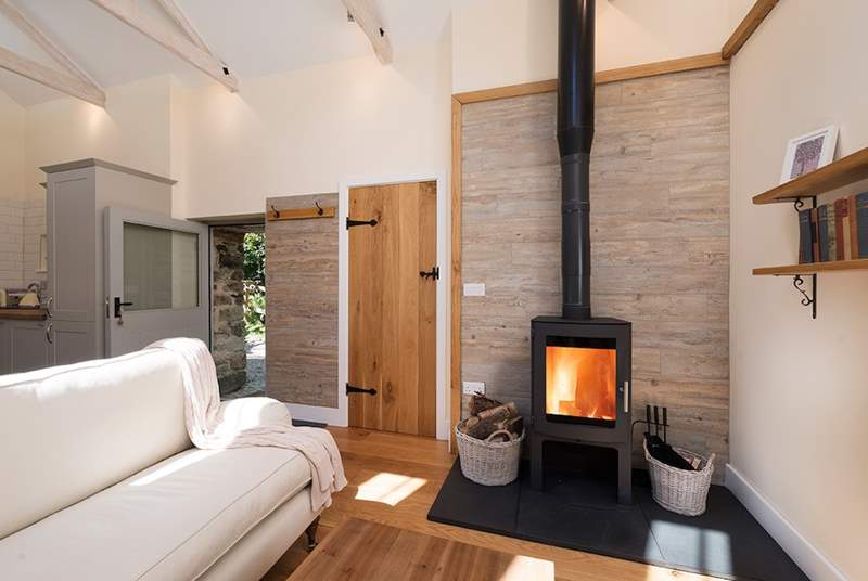 The glowing wood burner makes snuggling up and relaxing a real pleasure.
