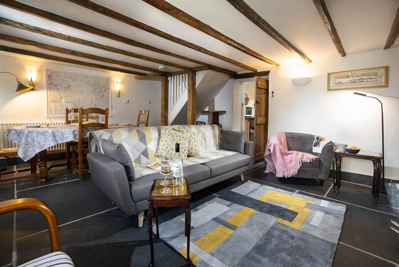 The wonderful sitting area offers a place to sit back and enjoy a room that also benefits from a log burner.