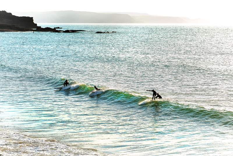 Head to the coast to watch the surfers enjoying the waves.