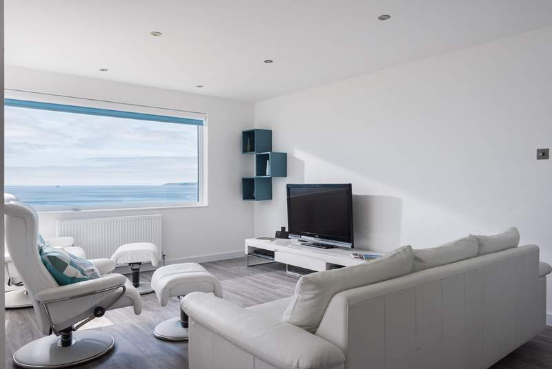 Two of the most comfortable chairs with individual foot rests and a large sofa mean that you can sit together with your feet up for maximum relaxation after a busy day out.