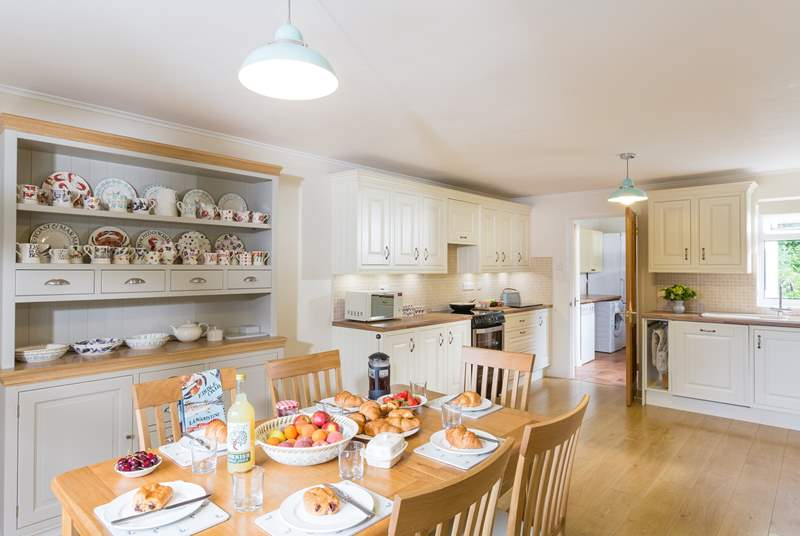 The very spacious and well-equipped kitchen/diner with the utility-room beyond with the door out to the garden.
