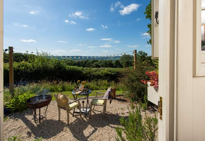 Sat in its own meadow to take advantage of the views, there is a patio-area with fire-pit barbecue, table and chairs.