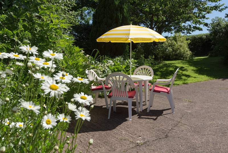 The gardens for you to enjoy are spread out beyond the hard standing-area.