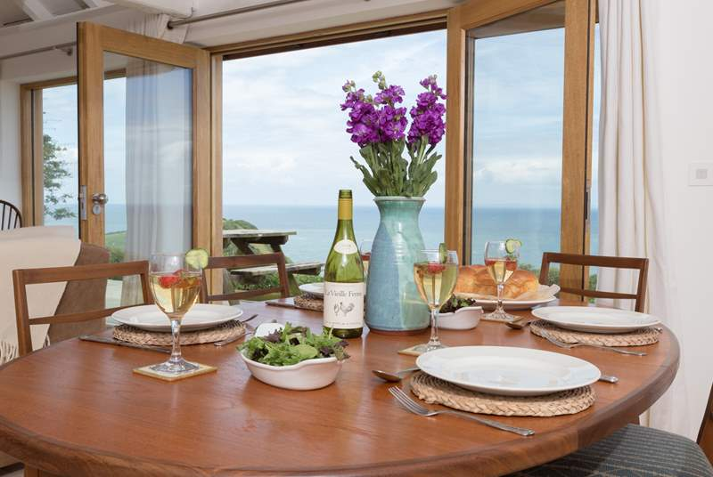 The dining-table shares that spectacular view.