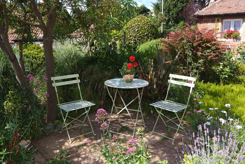There is a very pretty sitting out area under the trees in the side garden - as well as one in the courtyard at the back of the cottage.