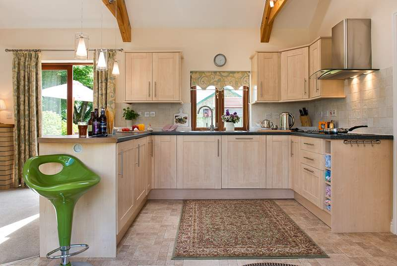 The stylish kitchen sits at one end of the open plan living-room.
