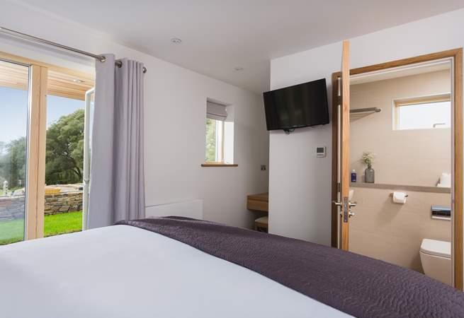 This ground floor bedroom also has an en suite shower-room.