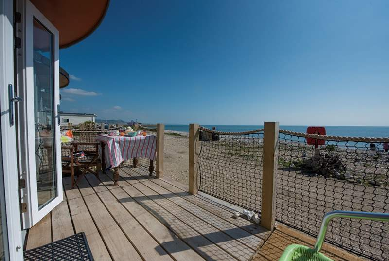 Relax and dine al fresco on your decking with the sound of gentle waves.