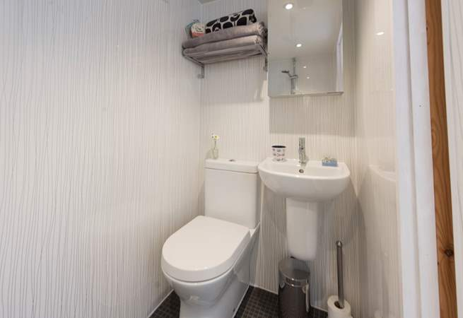 The wet-room has an electric shower, fully flushing WC, wash-basin and underfloor heating.