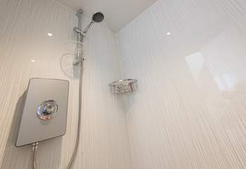 The wet-room has an electric shower, and cosy underfloor heating.