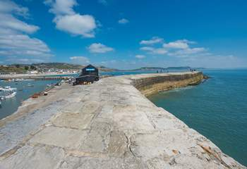 The iconic Cobb, with views across to Golden Cap, just a five minute walk from The Chalet on the Beach