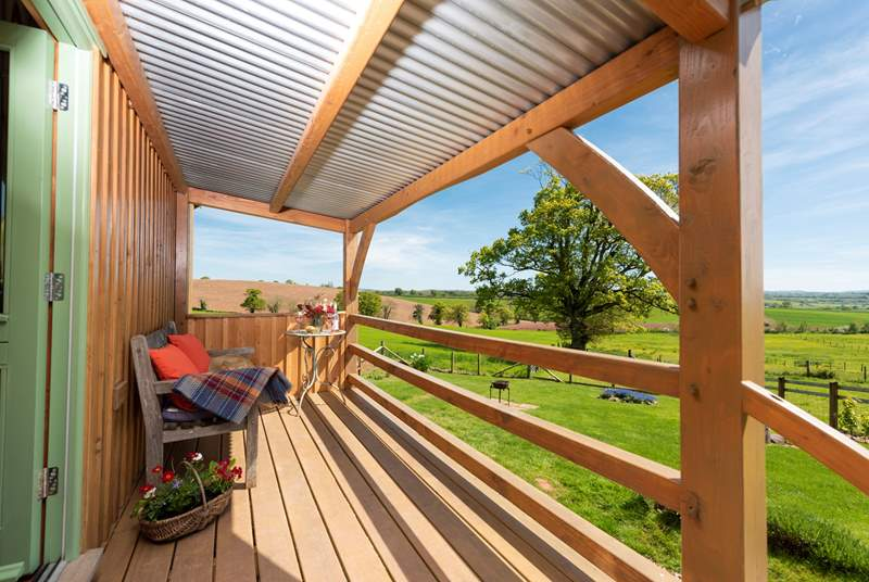 The raised deck is the perfect place to enjoy a glass of wine or two and drink in the far-reaching countryside views.