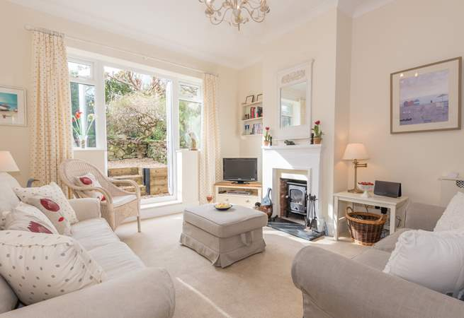 A set of patio doors from the light and cosy living-room lead out to the garden-area.