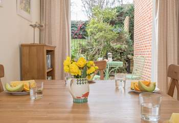The dining-room has a second set of patio doors that lead out to the very pretty patio and raised garden.