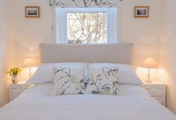 ...this double bedroom feels both fresh and cosy