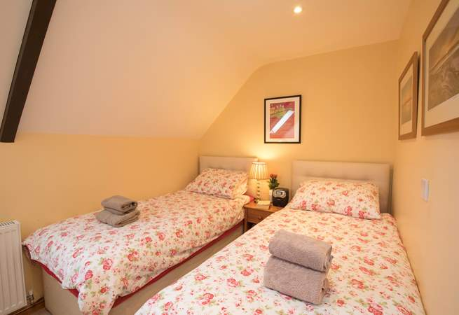 The twin bedroom is cosy and comfortable.