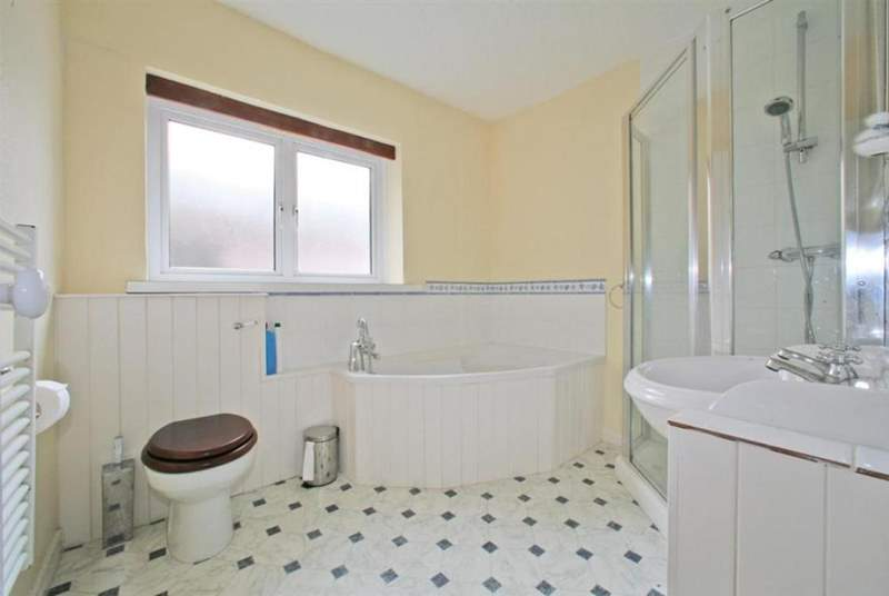 Bathroom with corner bath.