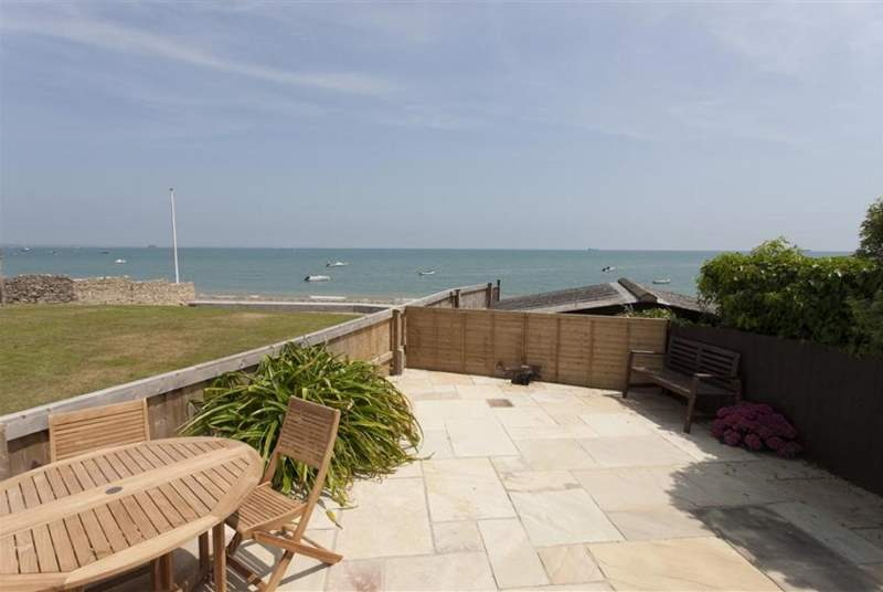 The spacious patio offers stunning views across the Solent.