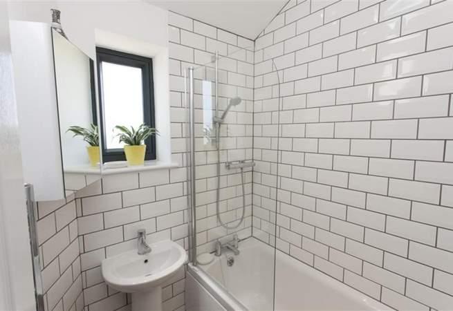 The modern, tiled bathroom on the ground floor.