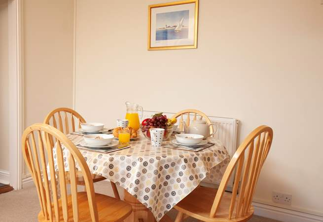 The dining-area is perfectly situated just steps from the kitchen.