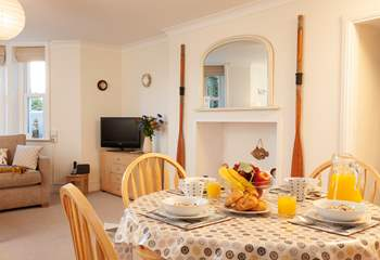 The sitting-room also has a dining-area, perfect for informal family meals.