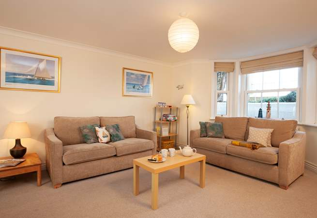 The sitting/dining-room is spacious and light, with plenty of room for relaxing or entertaining.