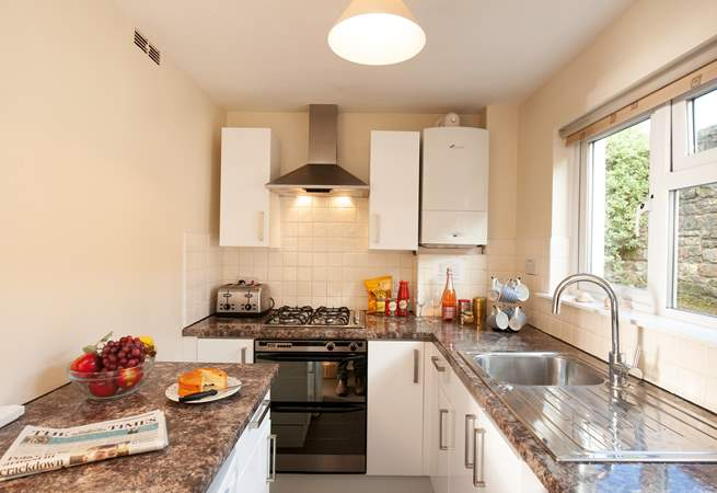 The modern, galley kitchen is bright and well-equipped with everything you are likely to need on your Island getaway.