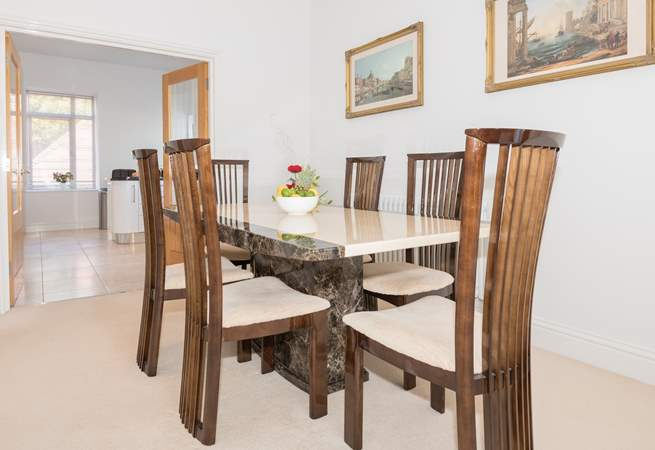 The dining-area and spacious kitchen beyond.