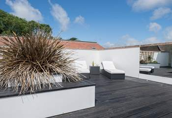 The secluded roof terrace is perfect for sunbathing.