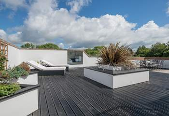 The roof terrace provides a large outside space for dining or sunbathing.