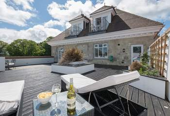 The large private terrace overlooking the communal gardens and parks beyond.