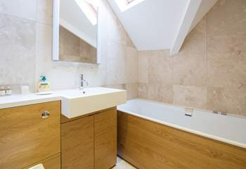 In addition to the two en suite shower-rooms there is a family bathroom.