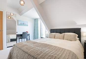 The second double bedroom also has an en suite shower-room and private balcony.