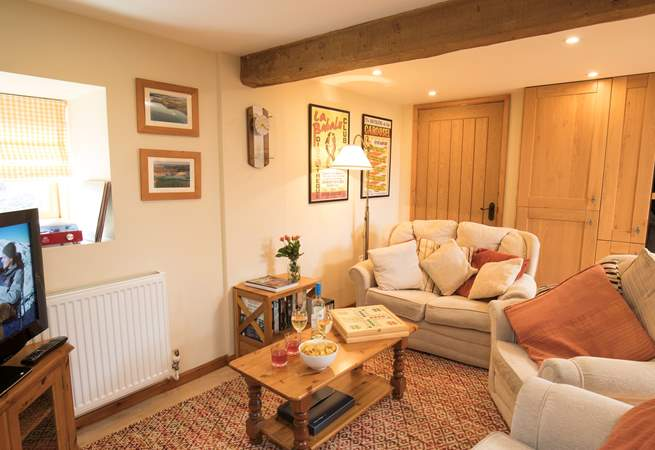 The cosy sitting-area is part of an open plan space, with a large kitchen and dining-area.