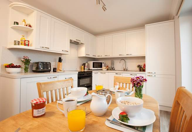 Enjoy family time together over meals in the modern kitchen and dining area.