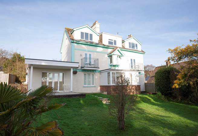 The back of the building where you will find 2 Bermuda overlooks a garden and countryside.