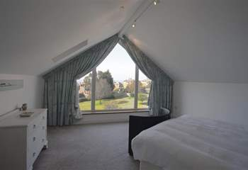 Master bedroom with king-size bed and views of the village and Solent beyond.