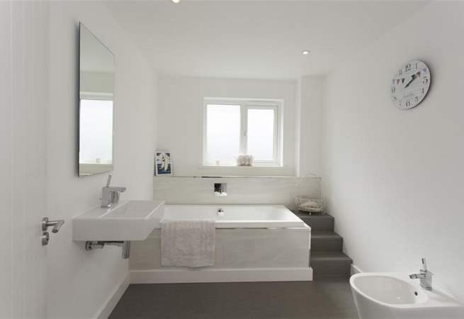 Luxury family bathroom with a bath to step down into.