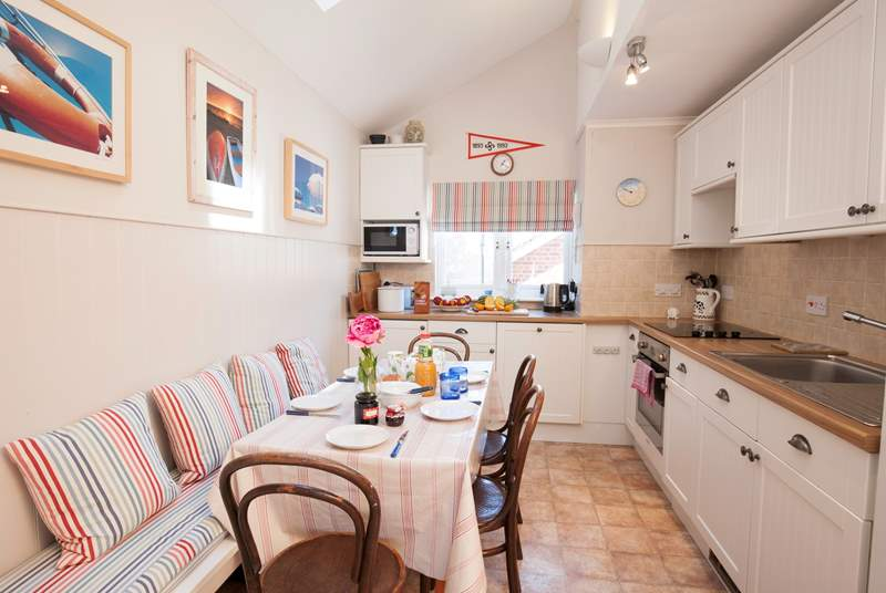 The lovely kitchen is well equipped and is a cute space to cook up your favourite meal.