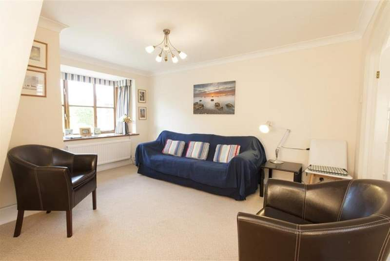 Bright and comfortable, the sitting-room leads on to a spacious kitchen/dining room.