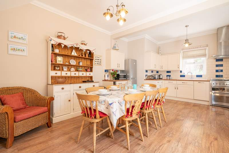 The kitchen/dining room on the ground floor showcases plenty of space for the family to spread out.