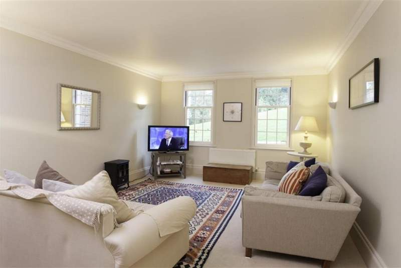 The comfortable sitting-room is perfect for relaxing after a day exploring the Island.